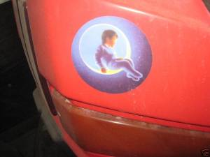 Michael Jackson's logo of little boy sitting on the moon is emblazoned on the bumper cars