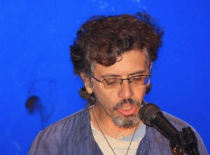 Poet Edwin Torres Reading at Parachute: The Coney Island Performance Festival at the New York Aquarium. Photo © Edward Hansen
