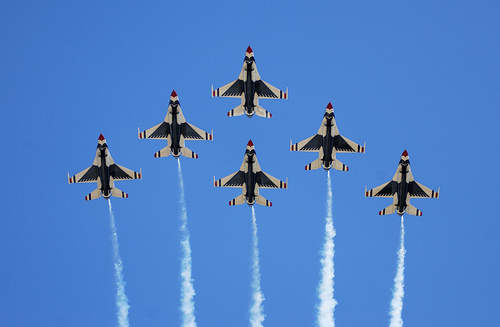 The U.S. Air Force Thunderbirds perform a 6-ship formation fly over during an airshow. U.S. Air Force photo by Senior Airman Michael Frye