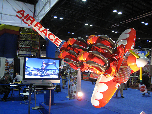 Zamperla's Air Race Ride Seat & Video on Display at IAAPA Attractions Expo in Orlando. November 17, 2010. Photo © Intercot via twitter