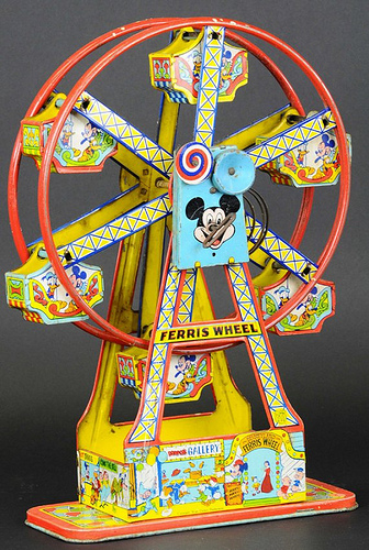 Up For Auction Vintage Cast Iron Tin Toy Ferris Wheels Amusing The Zillion